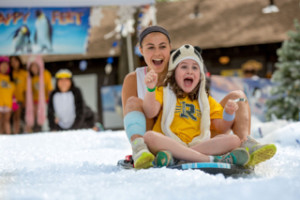 Arielle and camper sledding